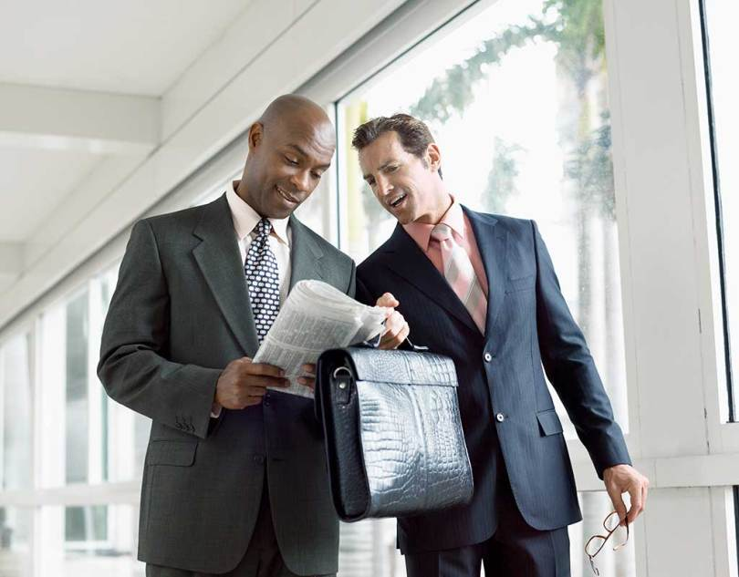 Two South African Business Man talking about business loans.