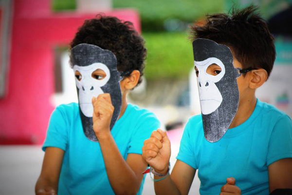 Two students enjoy their masks during Monkey Week. Photo courtesy of Juan Carlos Serio Silva.