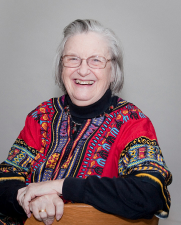 Ostrom's famous smile.  Photo courtesy of the International Land Coalition under a Creative Commons license from Flickr.com.