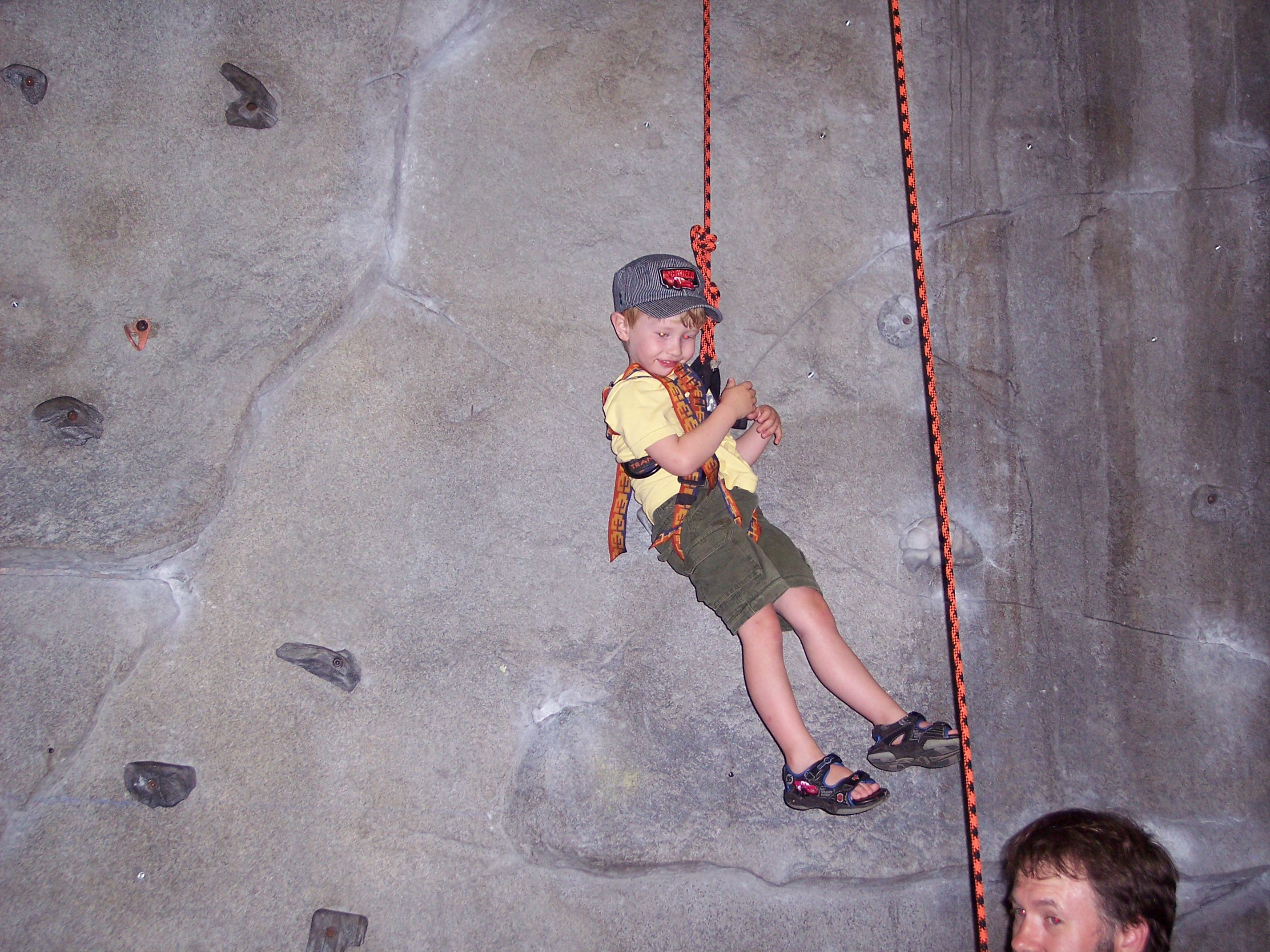 Toby enjoys the climbing wall
