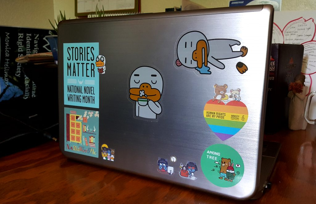 Laptop with several Kakao Friends stickers and a few others
