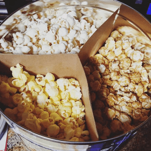 productivity hack treats popcorn bucket viewed from above with three types of popcorn separated by a three-way cardboard divider