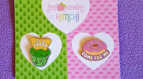 "Starting an Art Business a set of 2 food pins from KimChi and Just Peachy on a wide, green and pink backing card. One pin is a chip dipped into guacamole that reads ""You're so extra"" and the other is a donut with the words ""come for me"" below it. Donut come for me."