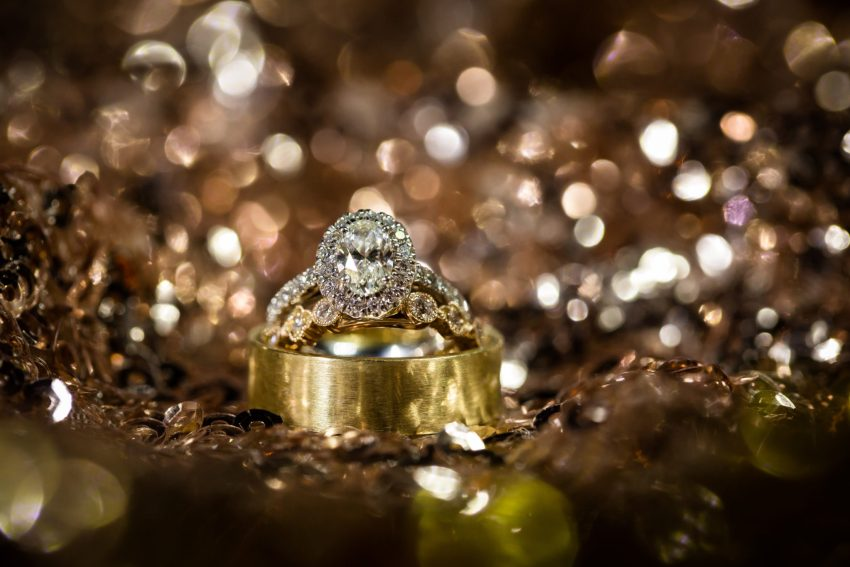 Best Fort Worth Wedding Photographers and a special ring shot of the weddings rings during the reception.