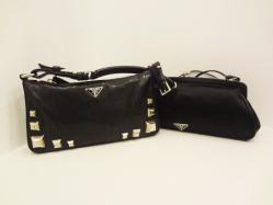 Prada black studded - $699, Prada black evening bag - $230