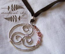 Triple spiral in sterling silver with copper accent, on suede cord. 2013