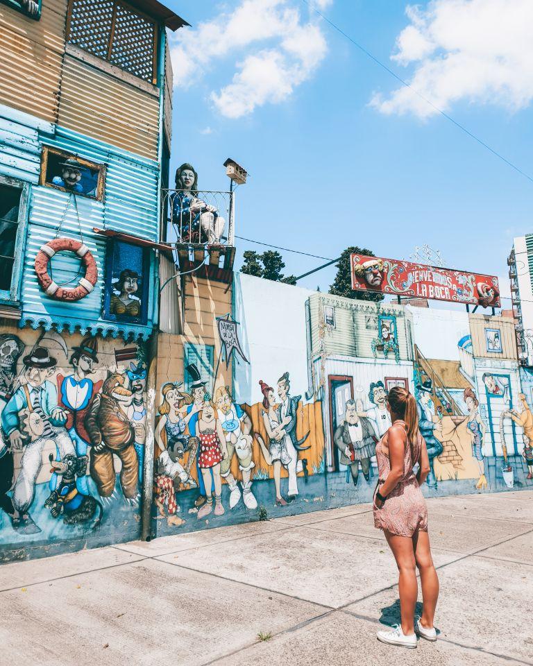 Girl looking at La Boca mural Buenos Aires Argentina