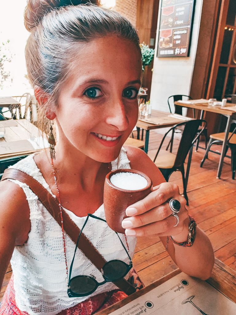 Girl drinking a Pisco Sour in Santiago Chile South America
