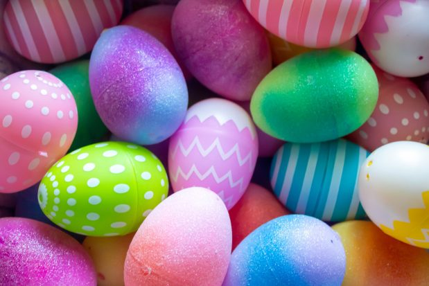 Multicoloured Easter eggs with a variety of patterns like stripes, dots, and zig zags