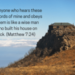 photo of a house built on the edge of a cliff, with a blue sky and clouds in the background, and Matthew 7:24 written to the side (Anyone who hears these words of mine and obeys them is like a wise man who built his house on rock.)