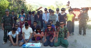 members of New Mon State Party and the apprehended young drug users (Photo: NMSP)