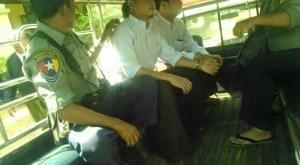 U Than Htike Thu and U Sun Moe Tun in a Police Van