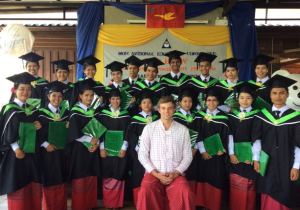 Bop Htaw graduates in group photo with their teacher at graduation ceremony (Photo: Bop Htaw)