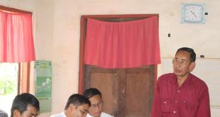 KNU Padoh Man Nyein Maung, standing next to NMSP Nai Aung Magay, speaking at the meeting (Photo: NMSP)