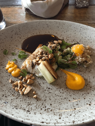 SALTED FILLET OF ICELANDIC COD* With butternut squash puree and a warm salad of butternut, jerusalem artichokes and quinoa. Served with roasted hazelnuts and mandarin sauce