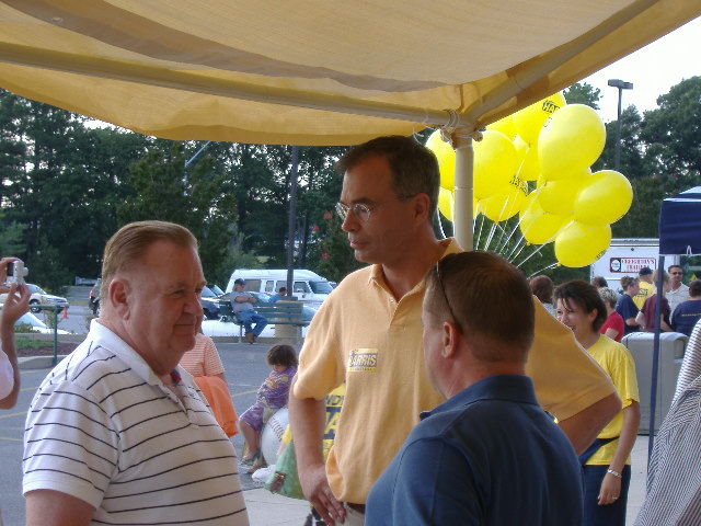 Congressional candidate Andy Harris (center, in yellow) talks issues with interested voters at the Delmarva Shorebirds game, July 25, 2008.