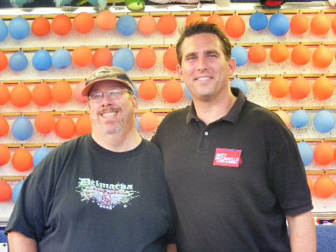 Kim took this picture of Matt and I at the St. Francis carnival. But we didn't toss any darts.