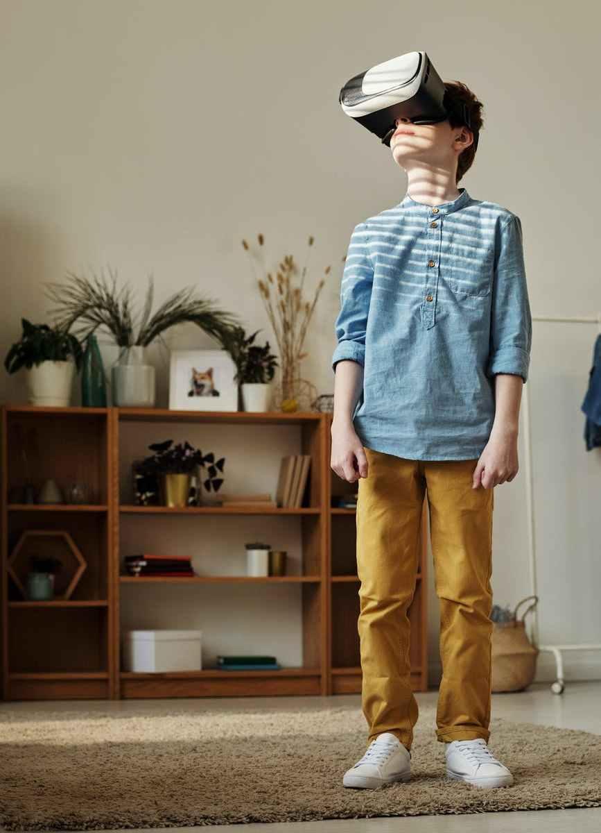 photo of boy using vr headset