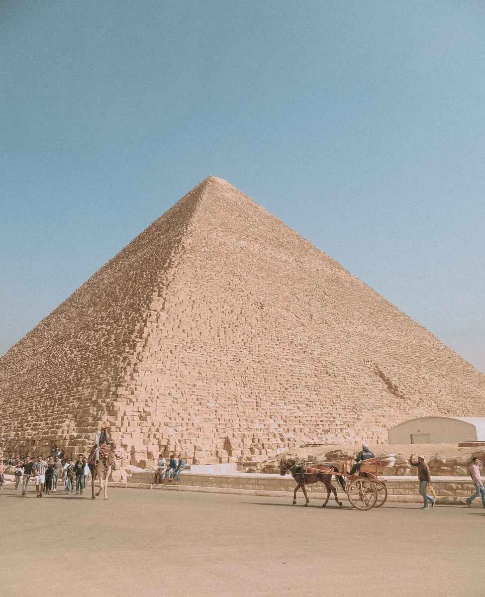 sandy desert with ancient sandstone pyramid