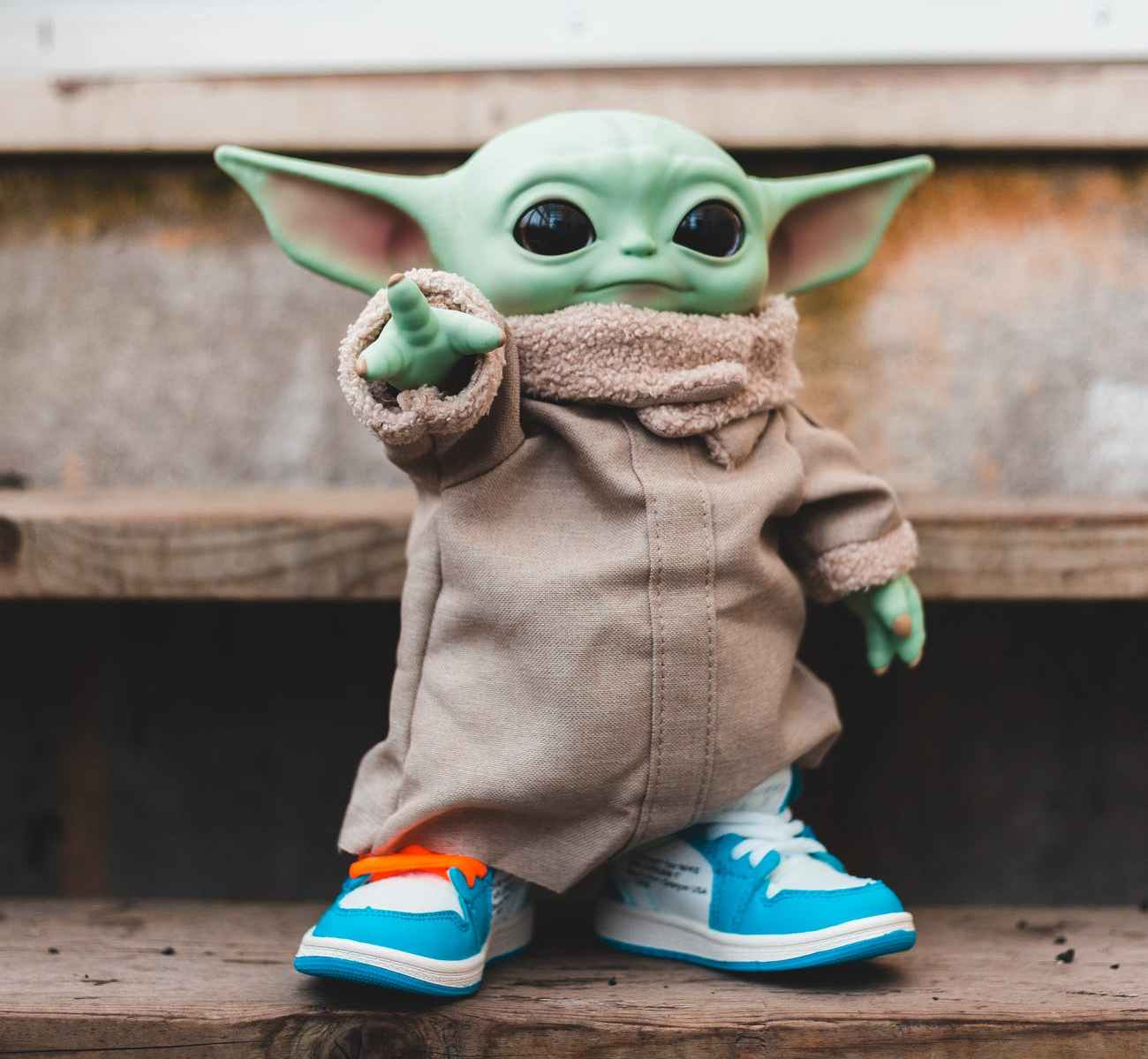 toy figure in modern sneakers on stairs