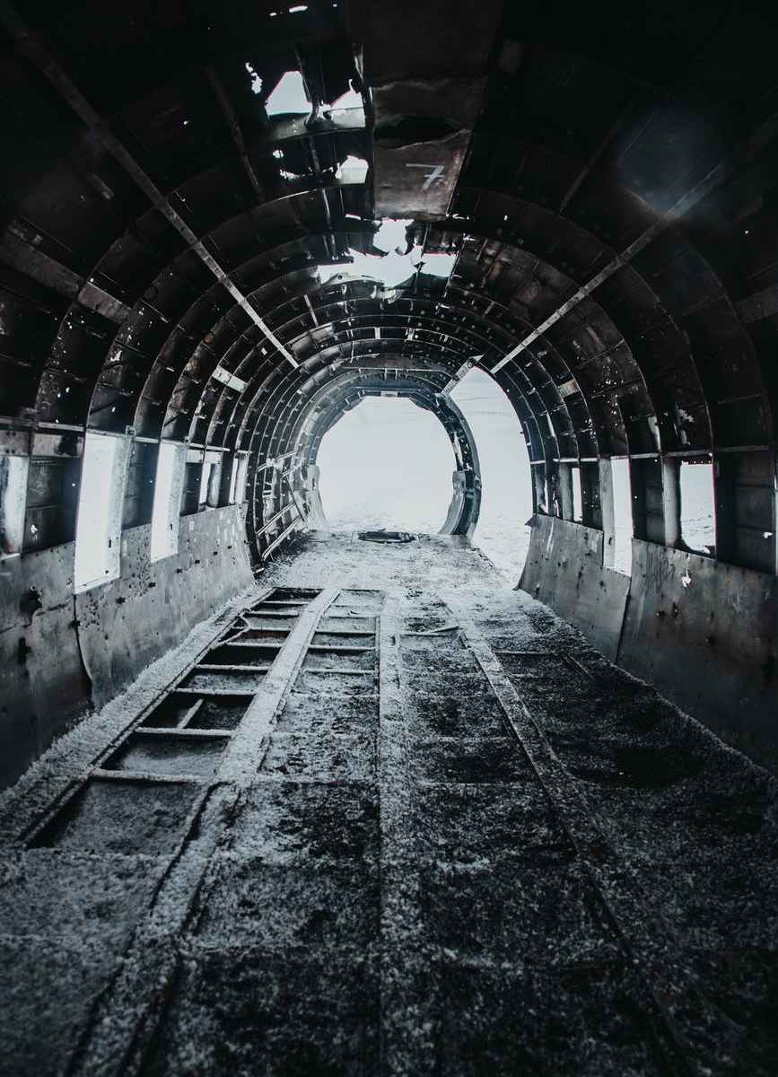 disused old grey aircraft with snow on floor