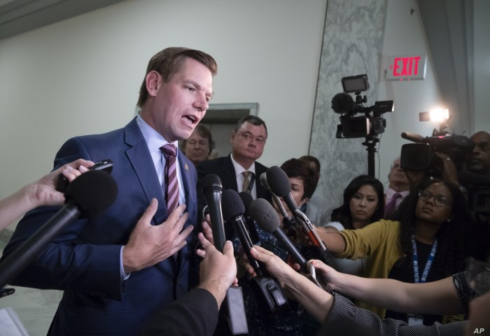 FILE - Rep. Eric Swalwell, D-Calif., pauses to speak with reporters on Capitol Hill in Washington, July 16, 2018.
