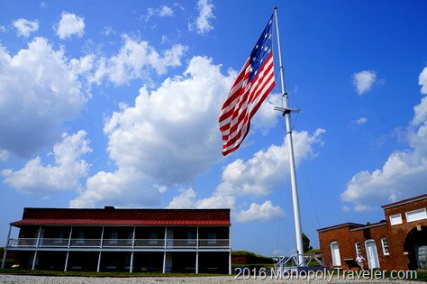 A huge American flag flying in the courtyard
