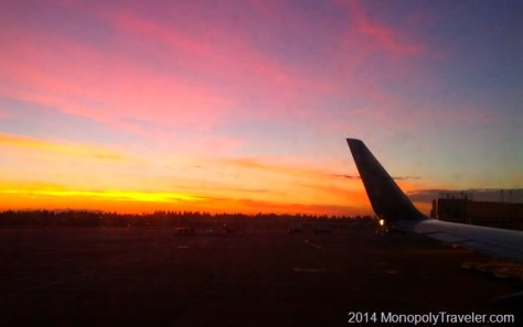 Taking Off in an Airplane at Sunset