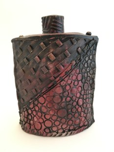 red and black pit fired vessel. Hand built