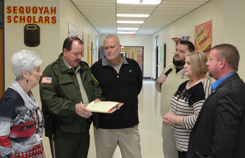 "Sequoyah High School Officials and Deputies review results of their ""Lock Down Drill"""