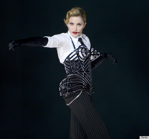 """TEL AVIV, ISRAEL - MAY 31: Madonna performs on stage during her """"MDNA"""" tour at Ramat Gan Stadium on May 31, 2012 in Tel Aviv, Israel. (Photo by Kevin Mazur/WireImage)"""