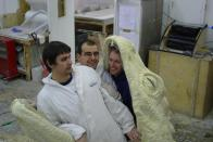 Members of the moulding crew with the Basilisk's skin, fresh out of the mould.