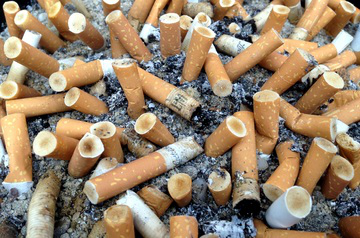 Stop Smoking Pile of used cigarettes in ash