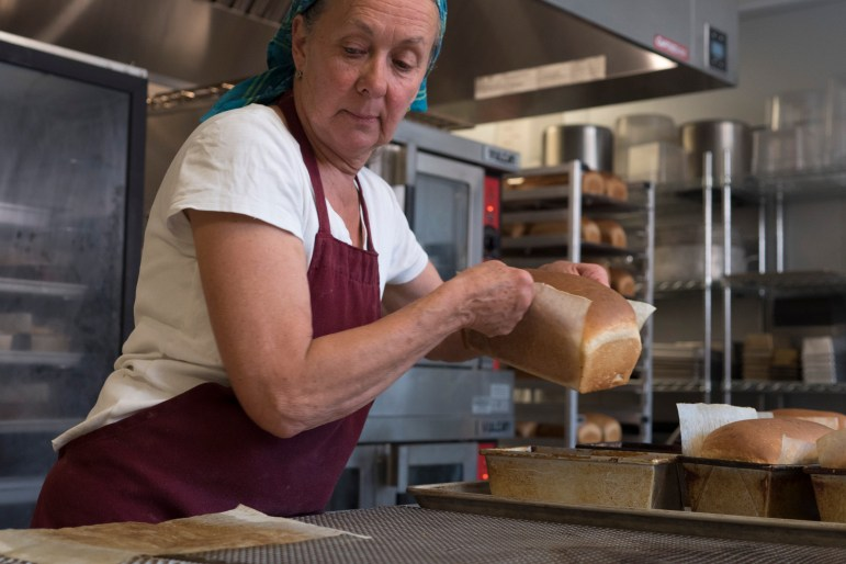 Livingston Food Resource Center Wendy Heckles bakes bread for distribution in the center's food pantry.