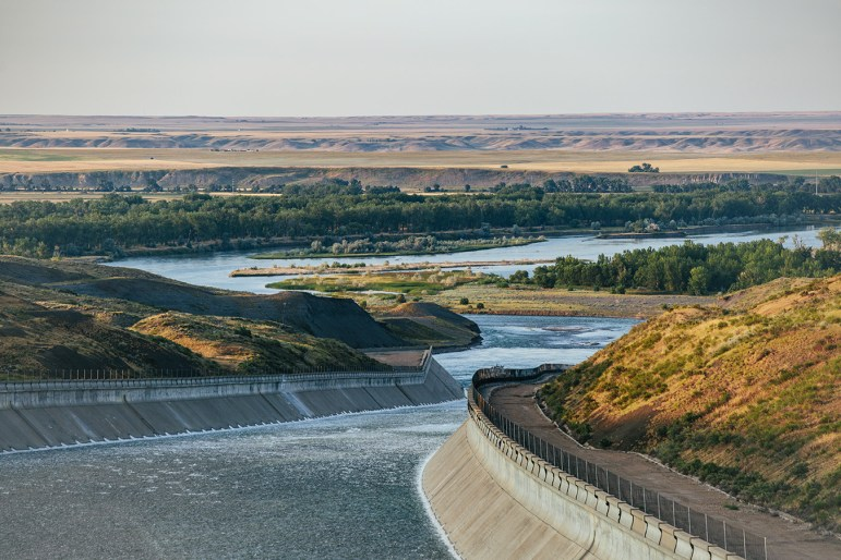 Water flows out of the Fort Peck Reservoir and down a mile-long concrete ramp where it flows into the Milk River near the southwestern border of the Fort Peck Indian Reservation