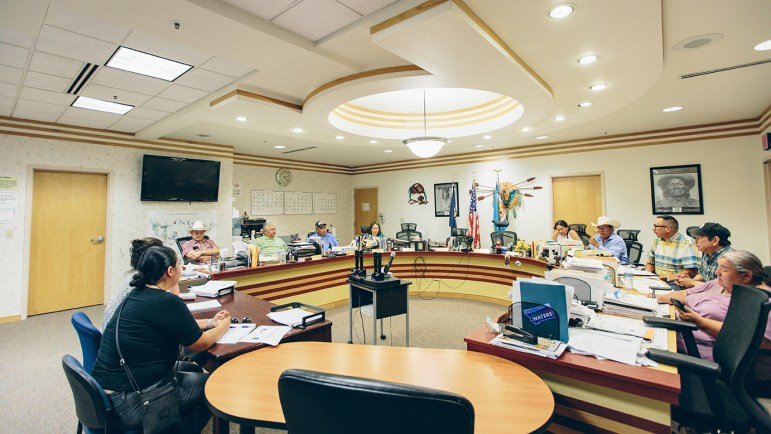 Members of the Tribal Executive Board of the Fort Peck Assiniboine and Sioux Tribes sit around a table in a large conference room and discuss matter of importance to the tribes.