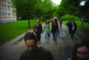 photo shows MT journalism students walking down a sidewalk.