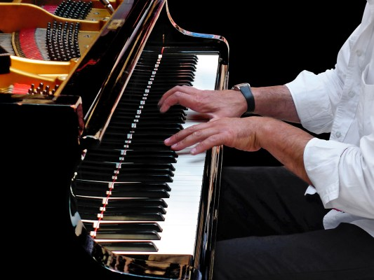 Concert Pianist at Grand Piano