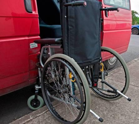 Transportation concept, wheelchair at van door