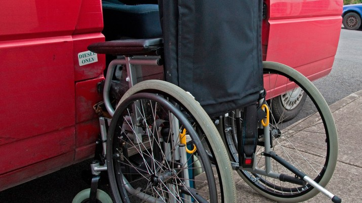 Transportation concept, wheelchair at van door