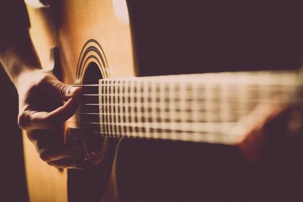 Picking a guitar