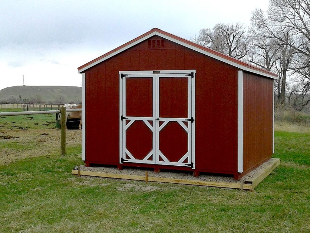 Red storage shed with white trim