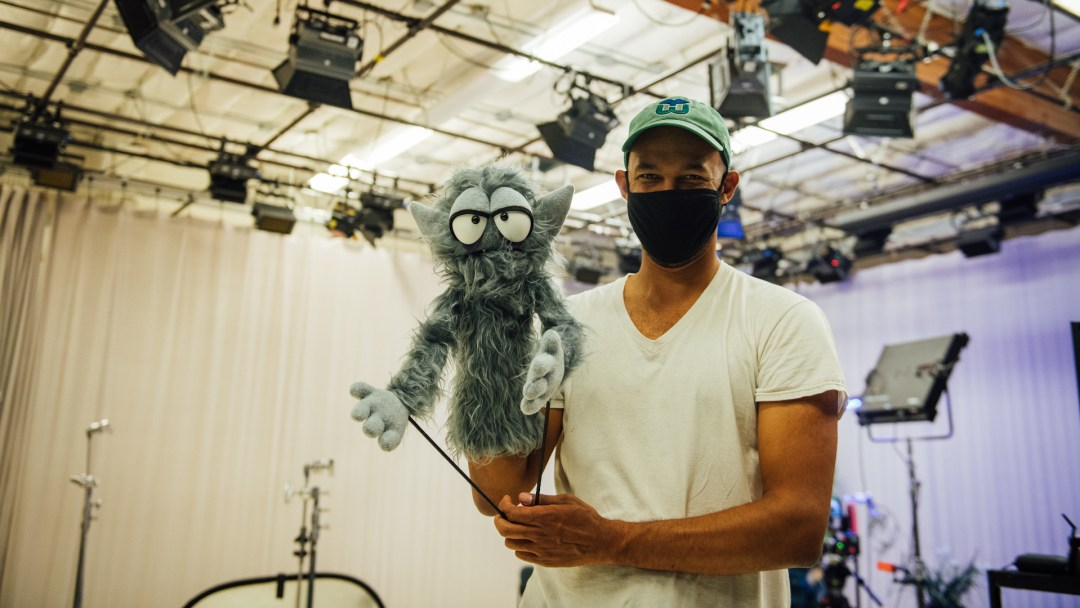 Director Jeff Oliver and the the Beast of Torpor puppet pose on set at Open Signal.
