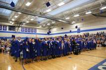 Students participate in the traditional throwing of the caps after Principal Carl Pauli presents the Class of 2017.