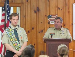 Photos by Lisa Bass - Recently named Eagle Scout Noah Dabney reviews his duties and obligations with Troop 145 Assistant Scoutmaster Matt Knost at a special ceremony.