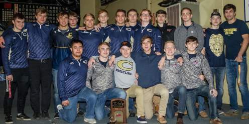 Photo by Kymn Davidson-Hamley Members of the Christiansburg wrestling team pose with their state trophy during Sunday's activities.