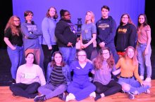 The crew of The Outsiders is pictured above: front row (left to right) Aimee Flint, directors' assistant; Tori Silverman, stage manager; Jess Kniskern, co-director; Erin Birchfield, co-director; Anna Payne, assistant stage manager; back row (left to right) Rose Griffith, running crew; Spenser Hurst, light and sound; Erin Herald, light and sound; Gracelynne Wolfe, running crew; Lauren Phillips, running crew; Brady Barrett, running crew; Cassie LeFreniere, running crew; and Joci Shelton, fight captain. Not pictured: Maddie Townley, running crew.