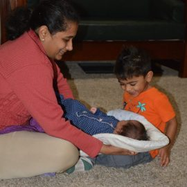 What in the world is a Topponcino? What new parents need to know about this simple infant support pillow!