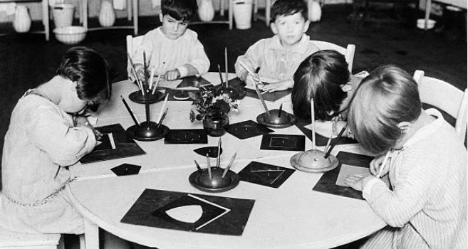 Photo of children w/ metal insets.