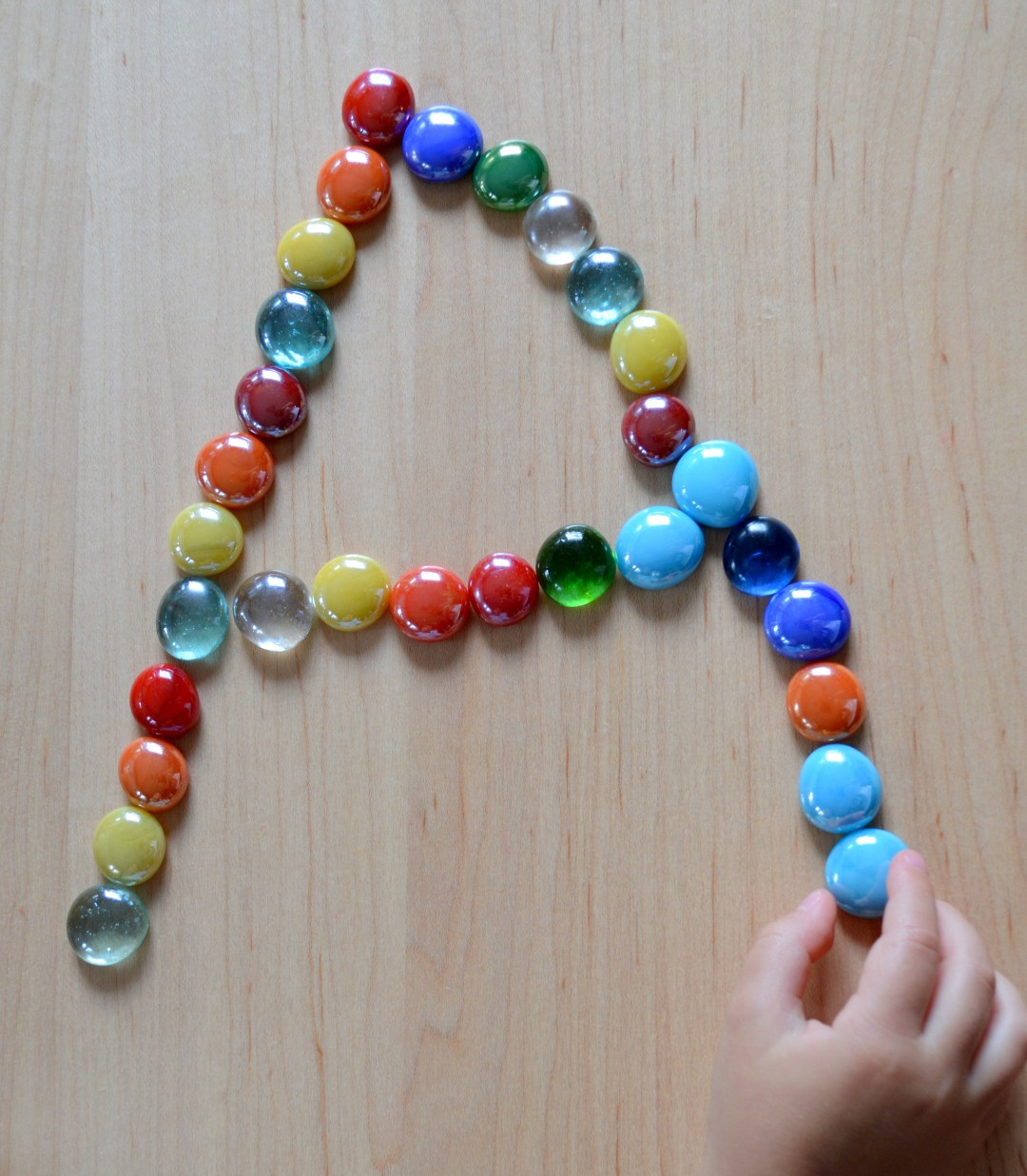 Letter A with marbles